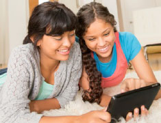 Two Girls with a Tablet